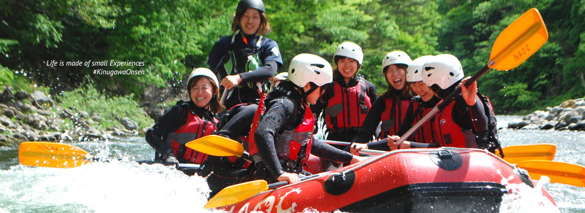 Excited visitors enjoying rafting and canyoning activities down a river in Kinugawa valley near Tokyo