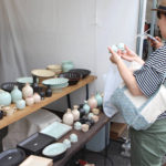 Many tents out at the Selecting an item at the bi-annual pottery fair
