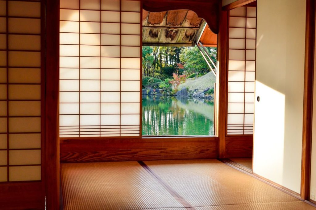 Room of a Japanese ryokan looking out onto a Japanese garden