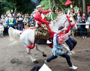 A boy on horse back taking part in the Izumoiwai Yabusame Festival near Tokyo